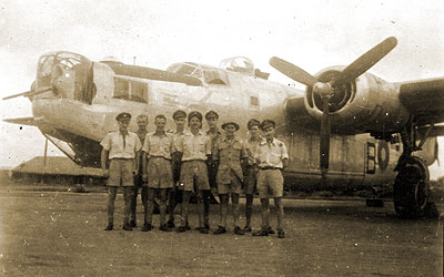 Ernest and his crewmates in front of Liberator bomber 1945