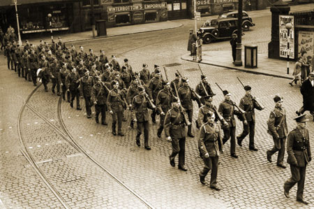 Bolton Artillery marching along  Trinity Street to the Railway Station summer 1939